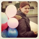 Corrie, having been laden with party balloons and cake by enthusiastic cake baker Grace (Copyright Corrie B)