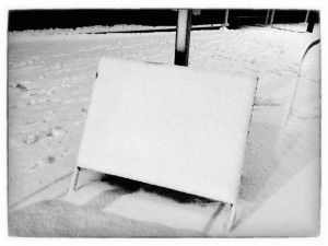 A very pretty snow-covered sign. (Copyright John S)