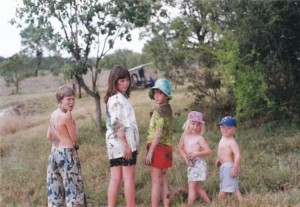 Childhood in Africa. I'm in the middle with the fetching red shorts.
