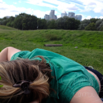Me, sleeping in a field of clover with the City in the background