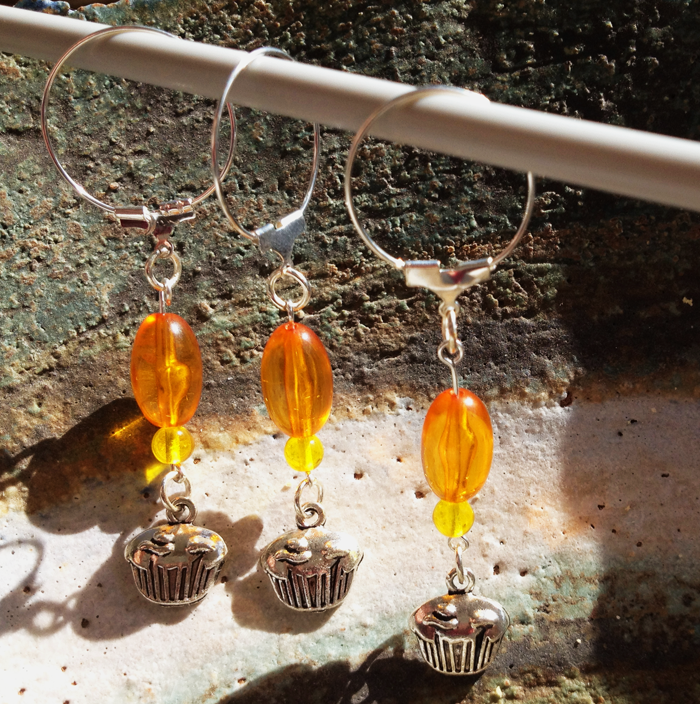Orange stitch markers made from Grace beads.