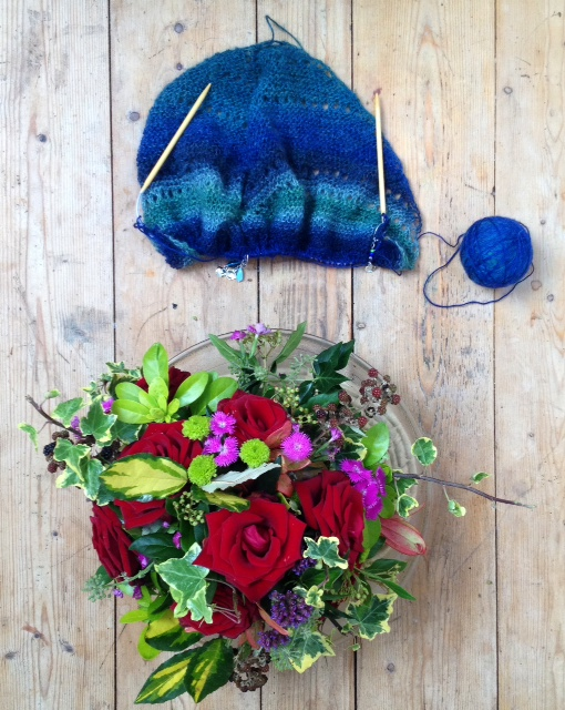 Birds Eye View with wedding roses and very blue-looking yarn.