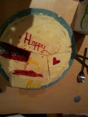 A cake, expertly cut by JS.