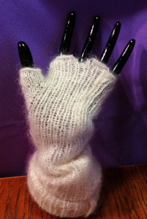 The glove on a hand - you can see the ripped BO edge by the middle finger.