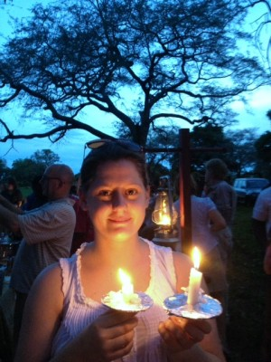 Me on Christmas Eve with candles at carols.