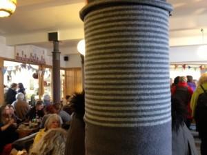 Yarn-bombed pillars.
