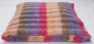 Stripy pencil case with popper closing.