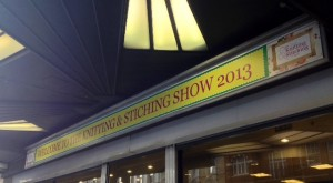 "A rather angular photograph of ""Welcome to the Knitting and Stitching Show 2013"""