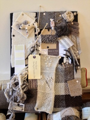Gorgeous mood-board with woven and knitted samples, and a needle-felted dog.