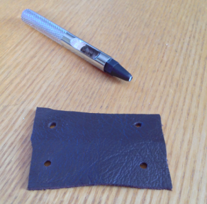 Holes punched into leather (don't forget it will be folded in half)