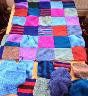 Aerial view of the Patchwork Blanket with squares to be completed at the bottom.