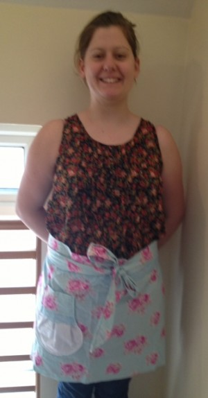 Modelling the flowery apron...slightly blurry and unflattering photo here, sorry about that!