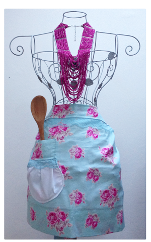 Apron on a gorgeous rose mannequin.