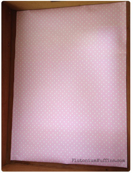Pink dotty lining paper.
