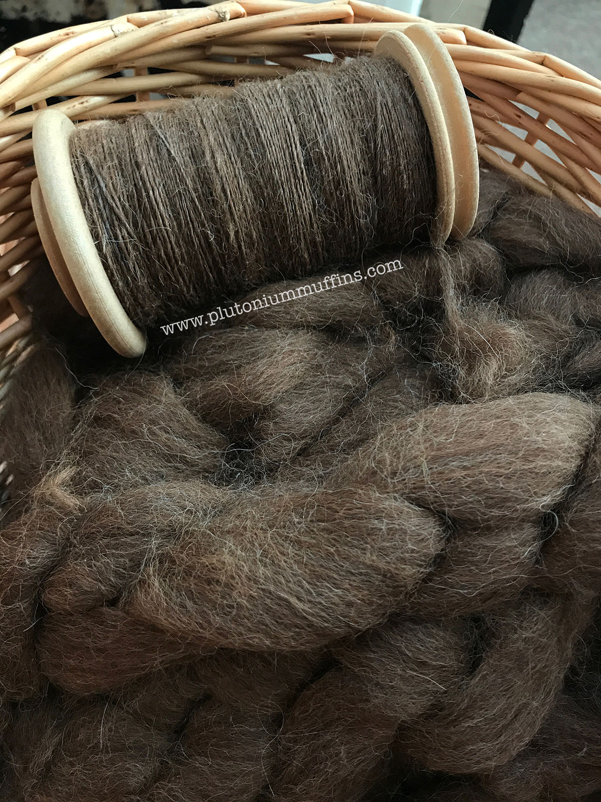 A basket full of alpaca fibre to turn into a jumper.