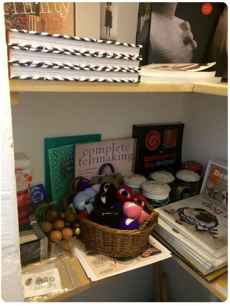 A corner of lovely books and crochet eyes for hats.