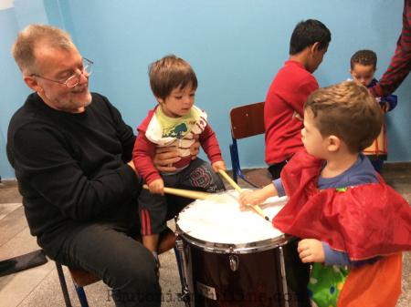 Teaching children how to drum.