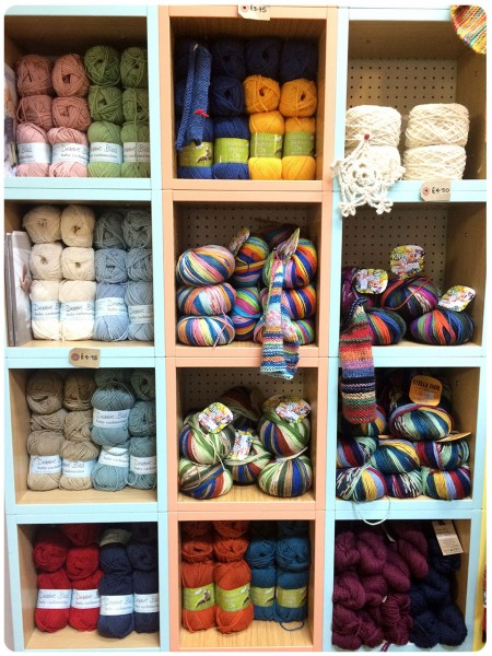 Brightly coloured yarn piles.