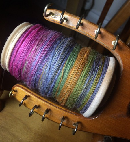 One very full bobbin of Dragon Yarn singles.