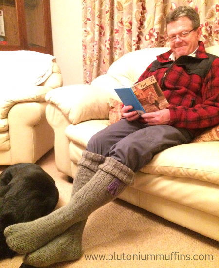 Dad enjoying his ridiculous welly socks with his faithful friend, Jet, at his feet.