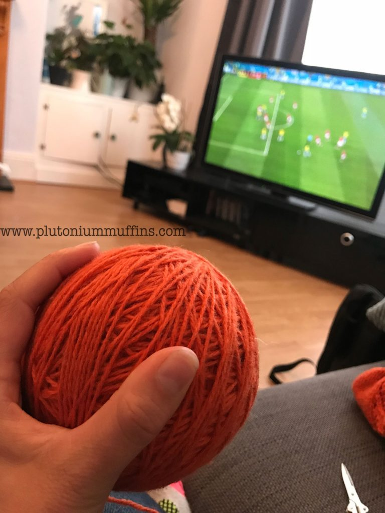 Watching football with knitting, a pleasant past time!