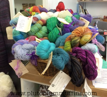 A basket filled to the brim with luxurious yarn.
