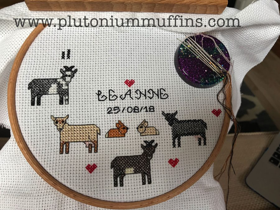 The sampler half done. The backstitch on the writing is done with two strands of floss, the backstitch on the animals using one strand.