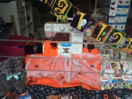 A Halloween display in the window.