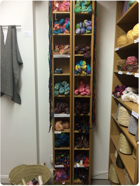 A bookcase full of handpainted yarns.