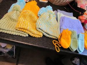 An assortment of hats and mitts by the wonderfully generous bigbadbrenda. Image copyright bigbadbrenda 2014.