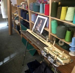 A domestic knitting machine, dwarfed by the rest!