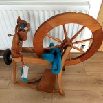 My spinning wheel and my roving ready to go.