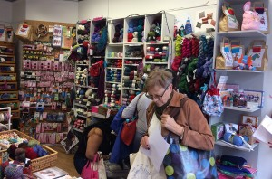 The inside of the shop with the big shelves of yarn.