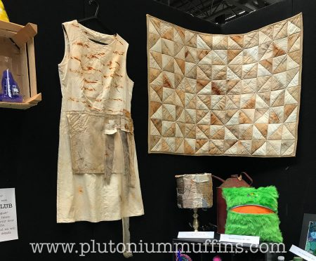 A quilt and apron from Inventor's Asylum, dyed with iron nails.
