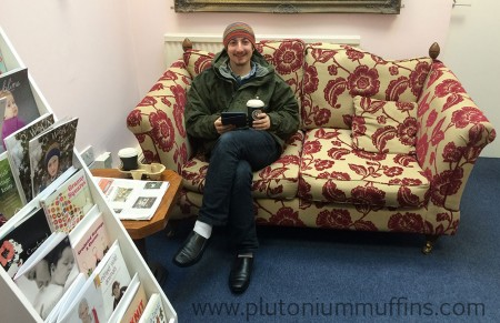 John enjoying the sofa in the Bluestocking Wool Shop.
