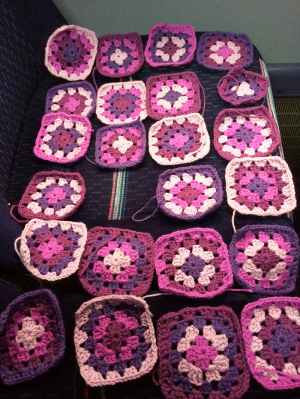 Laying out my Granny Squares while finishing the last two off.