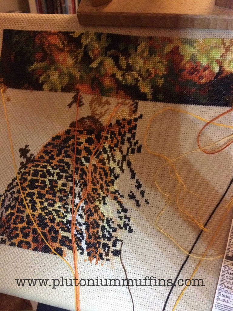 Progress on Leopard's Gaze cross stitch!