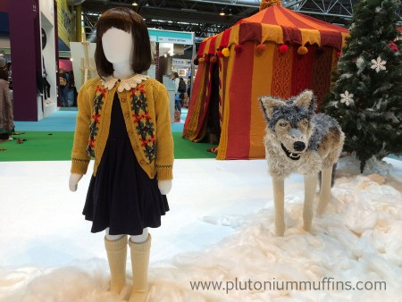 Lucy and a wolf. I love the cardigan - really wanted to get a pattern for it but couldn't find them to talk to!