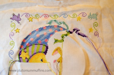 You can see the nose of a little bunny in this cross stitch sampler.