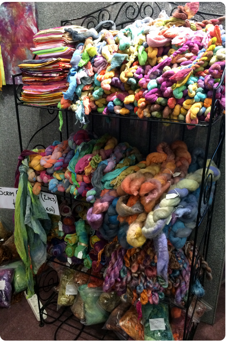 Stack of yarns and roving and felt and fabric...heaven.