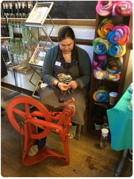 Heather spinning, with her gorgeous batts behind her.