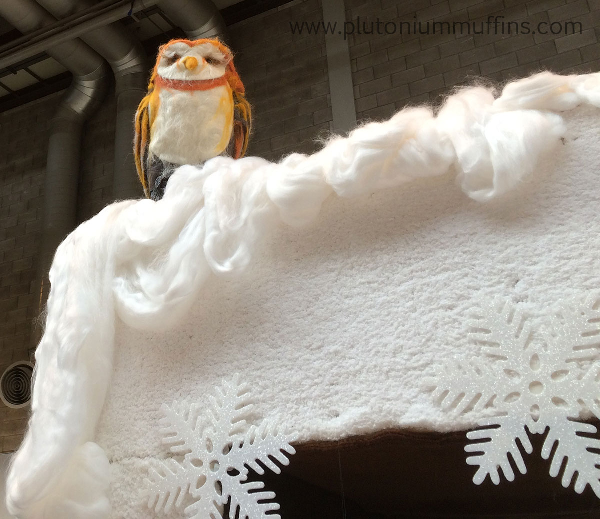 A cheeky little felted owl on top of the wardrobe.
