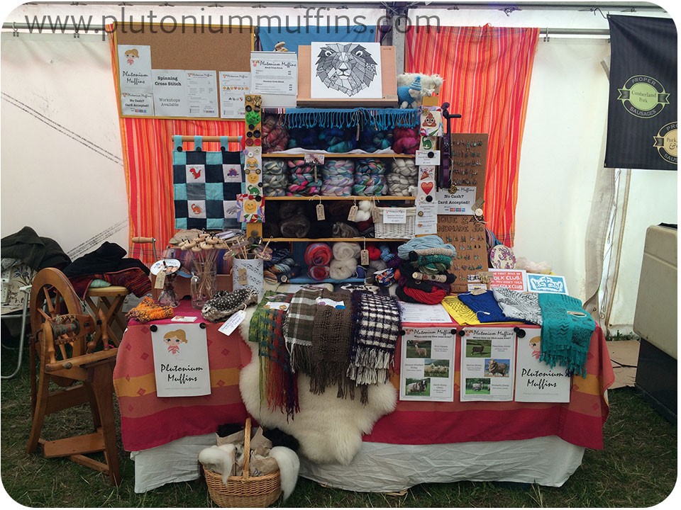 My stall at the festival where I taught stitching - look closely, you can see all the emoji cross stitch samples!
