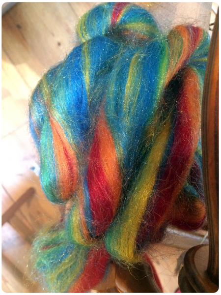 Rainbow fibre waiting to be spun.