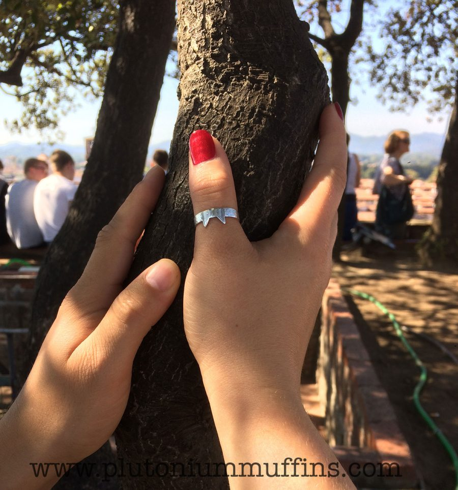 Clutching an ancient oak tree at the top of a tower in Italy. (The other hand is John's).