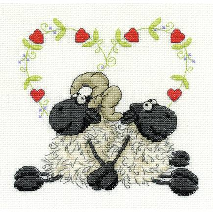 The finished sheep love cross stitch. (As it should have been.)
