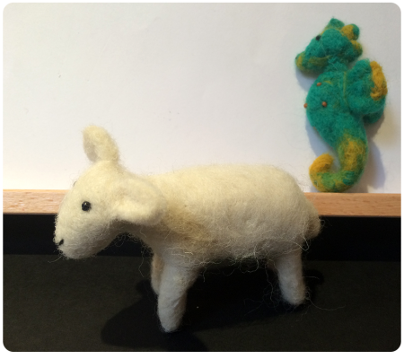 A needle-felted sheep and a little seahorse called Champion.