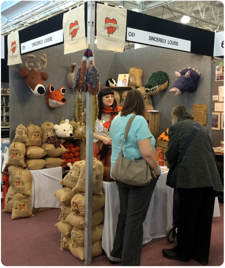 Sincerely Louise at the Spring Knitting and Stitching Show, chatting to customers.
