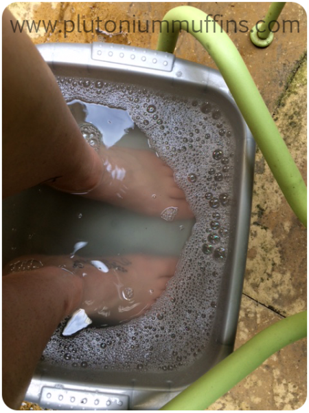 I just use a washing up basin which I bought in a pound shop about five years ago. I only use it for this purpose as I don't want my feet to soak in harsh chemicals, and don't want washing up to be done in foot water! I used to use a bath filled to foot-level with the relevant temp. water, but it cools much quicker and is much less comfortable.