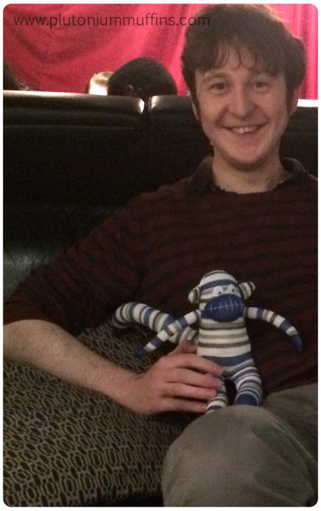 Our buddy with his new sock monkey.